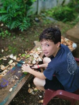 Zach practicing using a machete
